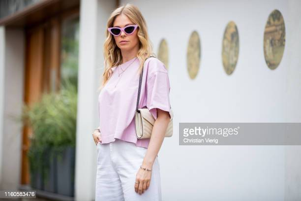 Inga Brauer is seen wearing white culotte Missguides pink Acne Studios tshirt YSL bag on July 06 2019 in Berlin Germany