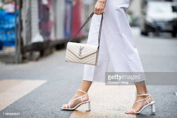 Inga Brauer is seen wearing white culotte Missguides white sandals Topshop YSL bag on July 06 2019 in Berlin Germany