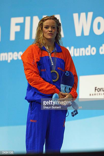 Inga De Bruijn of Netherlands celebrates after winning gold in the Womens 50m Freestyle Final during the 10th Fina World Swimming Championships 2003...
