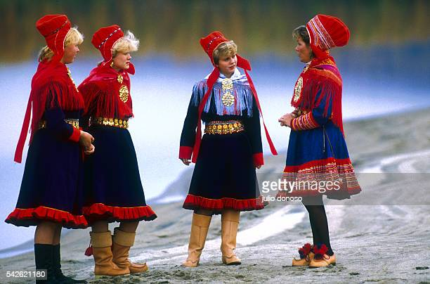 Inga Jusu and three of her friends talking and wearing traditional clothing from Alta and Karajsok