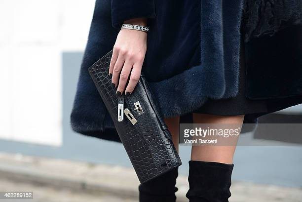 Inga Kozel poses wearing a Dior coat Manolo Blahnik shoes and Hermes bag during day two of Paris Haute Couture Spring Summer 2015 on January 26 2015...