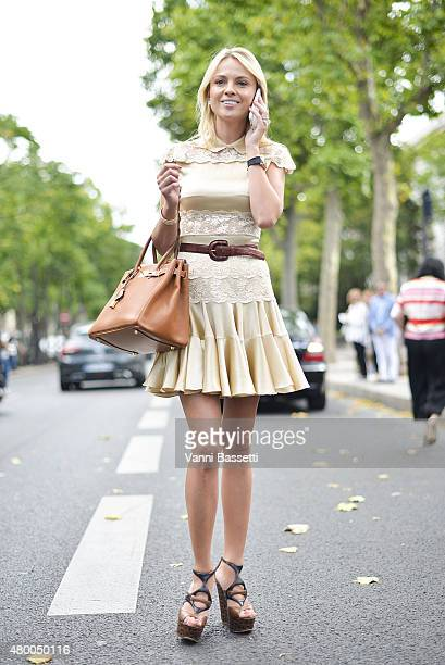 Inga Kozel poses wearing a Josef Statkus dress before the Zuhair Murad show at the Palais de Tokyo on July 9 2015 in Paris France