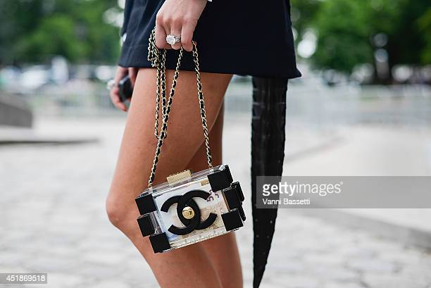 Inga Kozel poses wearing an Azzedine Alaia Couture dress and a Chanel clutch after Chanel show on July 8 2014 in Paris France