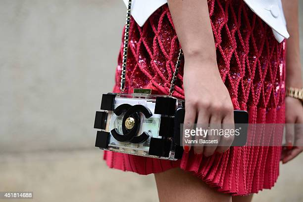 Inga Kozel poses wearing Azzedina Alaia Couture top and skirt and Chanel clutch after Dior show on July 7 2014 in Paris France
