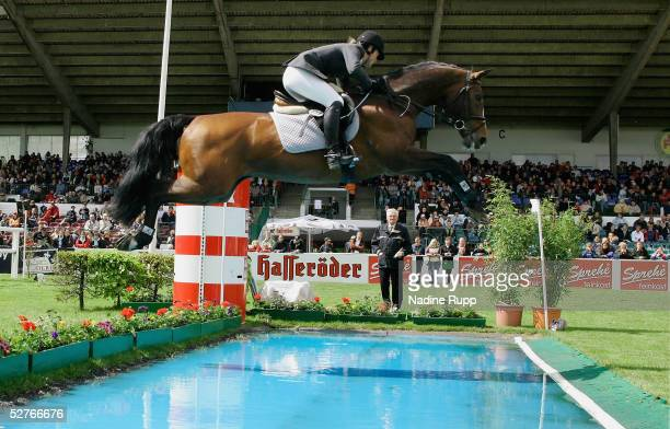 Inga Rauert of Germany jumps on her horse Lerano over the waterpool to victory in the Sprehe Feinkost Preis of the German Jumping and Dressage Grand...