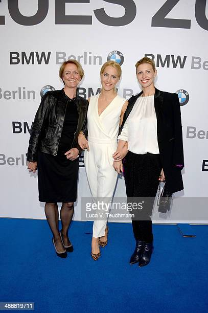 Inga Vollmann Judith Rakers and Katerina Schroeder attend Housewarming at BMW Dealership on May 8 2014 in Berlin Germany