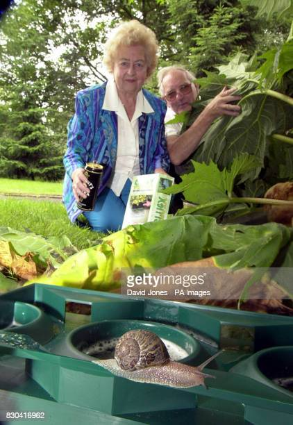 Inge Beaumont and her husband Clarrie with their slug and snail exterminator in action in the garden of their home near Kidderminster Worcestershire...