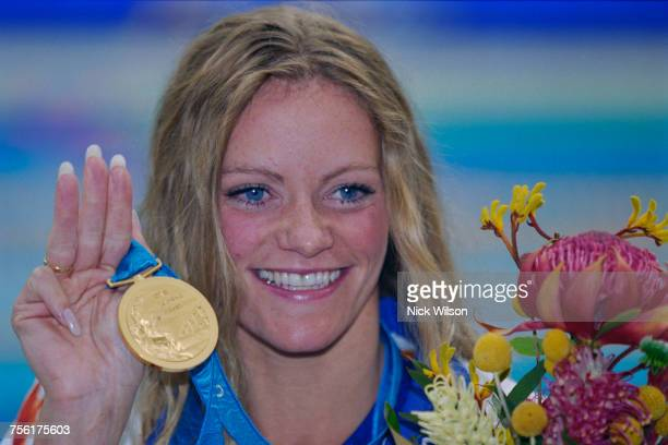 Inge de Bruijn of the Netherlands celebrates with her gold medal after winning the Women's 50 metres Freestyle event at the XXVII Summer Olympic...