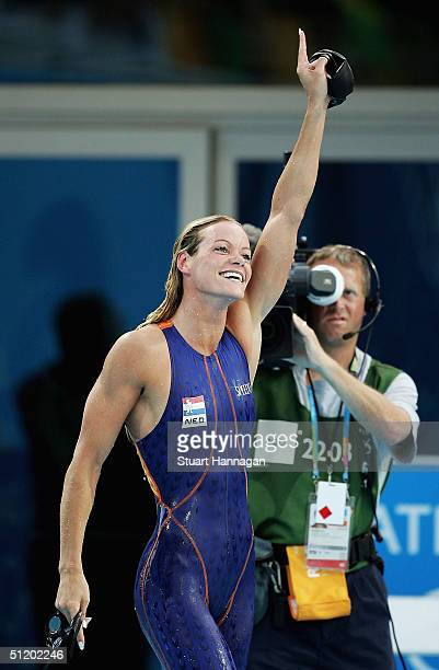 Inge de Bruijn of the Netherlands waves to the crowd after winning the gold medal in the women's swimming 50 metre freestyle final on August 21 2004...