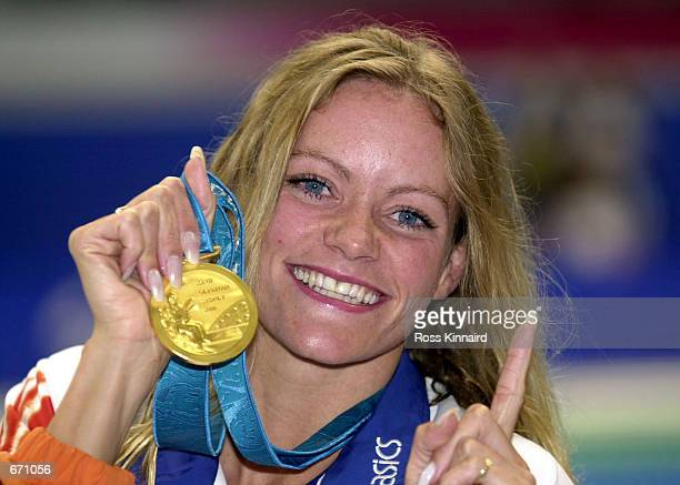Inge de Bruijn of the Netherlands with her gold medal after her victory September 21 2000 in the Women's 100m Freestyle Final during the 2000 Sydney...