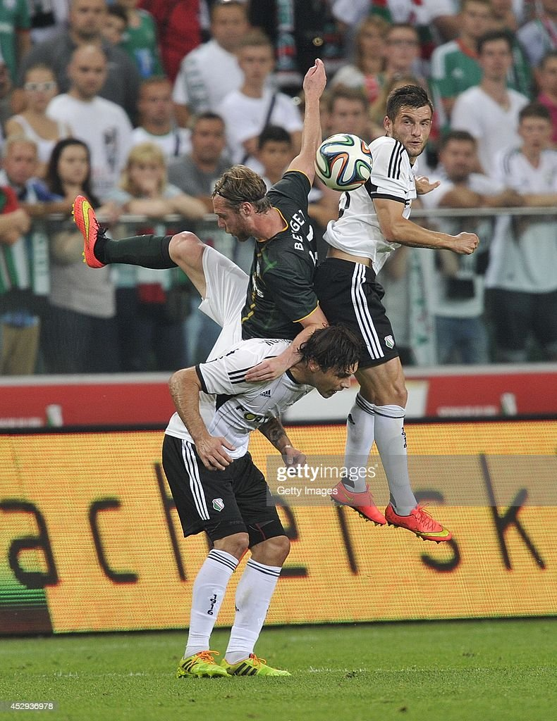 Inge Jo Berget of Celtic battles with Lukasz Broz and Ivica Vrdollak of Legia during the third qualifying round UEFA Champions League match between Legia and Celtic at Pepsi Arena on July 30, 2014 in Warsaw, Poland.