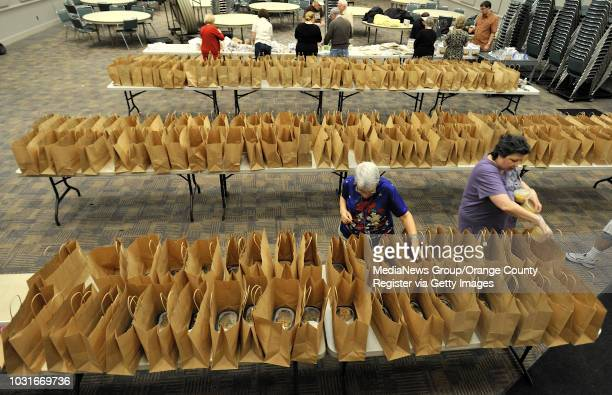 BEACH CA Inge Johnson left and Esther Falk fill bags with kosher foods as the and other volunteers at the Jewish Community Center in Long Beach CA...