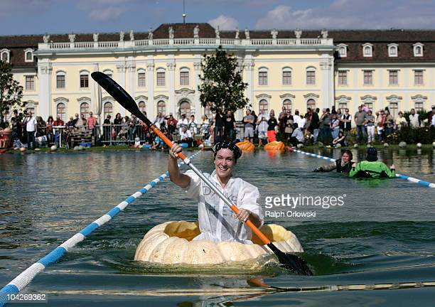 Inge Schrimps paddles in a hollowed pumpkin across a lake at Ludwigsburg Castle on September 19 2010 in Ludwigsburg Germany During the annual...