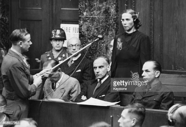 Inge Viermetz, the only woman defendant being tried before Tribune 1 in the RuSHA Nuremberg Trials, stands up to plead 'not guilty' to being...
