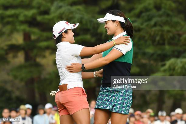 InGee Chun of South Korea greets Nasa Hataoka of Japan during the final round of the Japan Women's Open 2017 at the Abiko Golf Club on October 1 2017...