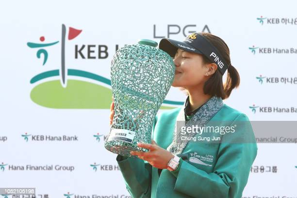In-Gee Chun of South Korea holding the trophy on the 18th green after winning the LPGA KEB Hana Bank Championship at Sky 72 Golf Club on October 14,...
