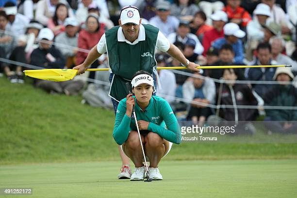 InGee Chun of South Korea lines up her putt on the 18th green during final round of the Japan Women's Open 2015 at the Katayamazu Golf Culb on...