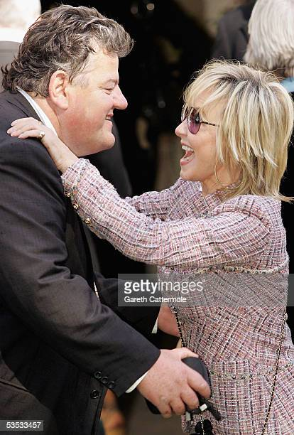 inger Lulu and Actor Robbie Coltrane attend the wedding of musician Jools Holland and Christabel McEwen at St James's Church Cooling on August 30...