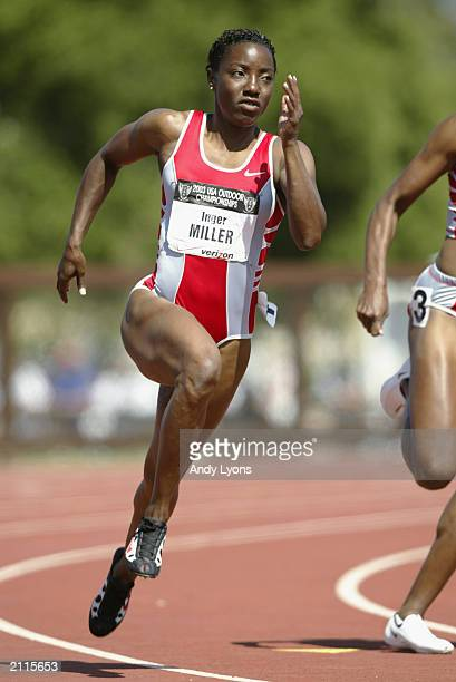 Inger Miller competes in the women's 200m prelims at the USA Outdoor Track and Field Championships on June 21, 2003 at Cobb Track and Angell Field at...