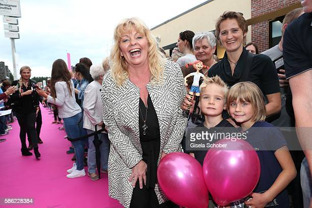 Inger Nilsson and fans during the late night shopping at Designer Outlet Soltau on August 5 2016 in Soltau Germany