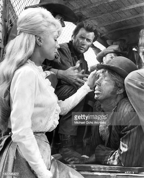 Inger Stevens examines man in a scene from the film 'Hang 'Em High' 1968