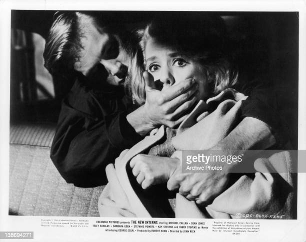 Inger Stevens is grabbed by unidentified man in a scene from the film 'The New Interns' 1964