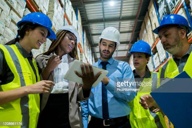 ingeriero man meets with some of his employees to discuss company issues - labor union stock pictures, royalty-free photos & images