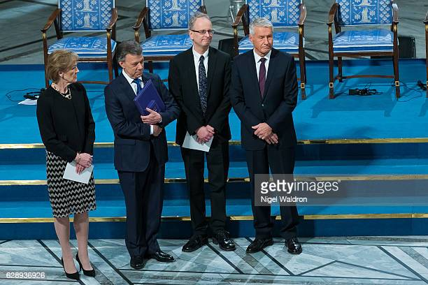 Inger-Marie Ytterhorn of Norway, President Juan Manuel Santos of Colombia, Henrik Syse of Norway and Thorbjørn Jagland of Norway attend the Nobel...
