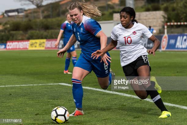 Ingibjorg Sigurdardottir of Iceland women Ashley Lawrence of Canada women during the Algarve Cup 2019 match between Canada and Iceland at Estadio...