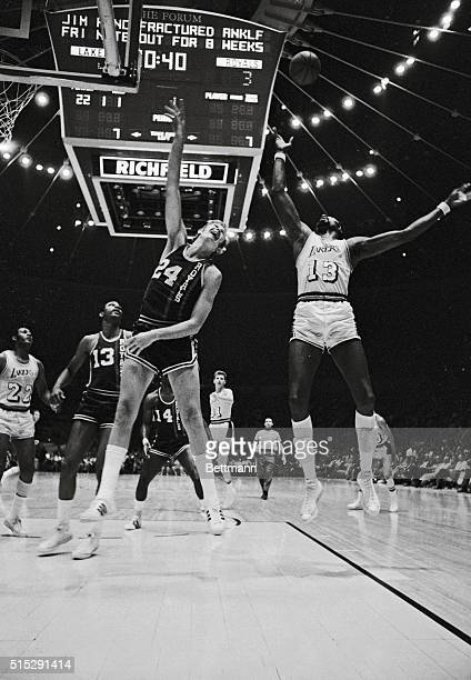 Los Angeles Lakers Wilt Chamberlain and Cincinnati Royals Connie Dierking go high in the air for ball during first quarter of game at the Forum...