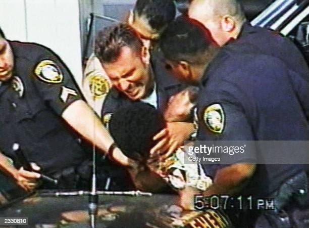 Inglewood police officer Jeremy Morse appears to choke 16yearold Donovan Jackson on July 8 2002 in Inglewood California Jackson was riding in a car...