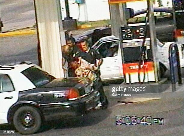 Inglewood police officer Jeremy Morse lifts 16yearold Donovan Jackson before slamming his body onto the back of a police car on July 8 2002 in...