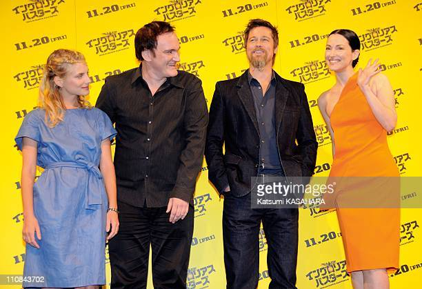 Inglourious Basterds Photocall In Tokyo Japan On November 04 2009 American actor Brad Pitt second from right poses for cameras with other staffs of...