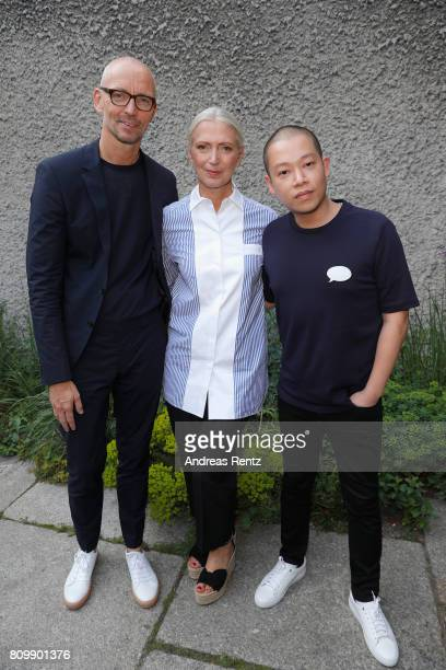 Ingo Wilts Christiane Arp and Jason Wu arrive to the Hugo Boss presentation during 'Der Berliner Mode Salon' Spring/Summer 2018 at St Agnes Church on...