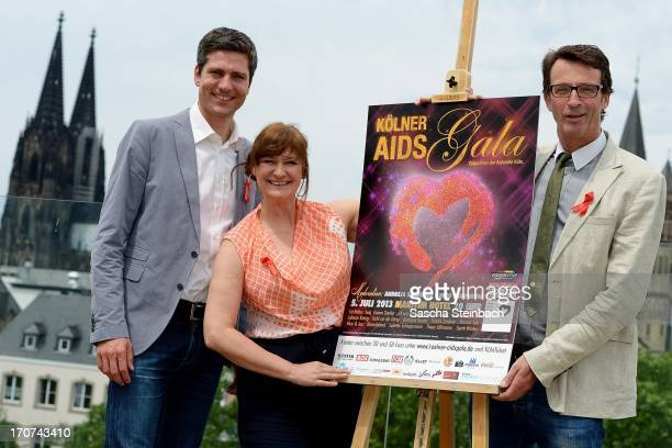 Ingo Zamperoni, Andreja Schneider and managing director Michael Schuhmacher pose during the Aidshilfe Cologne Photocall at Maritim Hotel on June 17,...