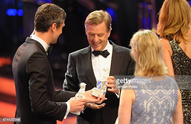 Ingo Zamperoni hands over the trophies for the best information coverage, to Klaus Kleber and Angela Andersen during the Bayerischer Fernsehpreis...