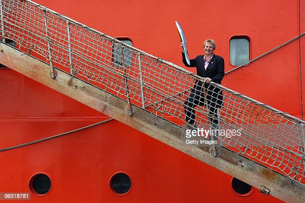 Ingoing Station Leader Marilyn Boydell escorts the Melbourne 2006 Queen's Baton up the gangplank of the Aurora Australis prior to its departure for...
