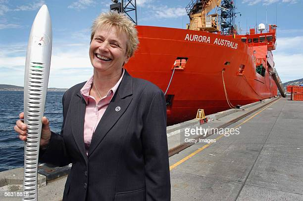 Ingoing Station Leader Marilyn Boydell stands with the Melbourne 2006 Queen's Baton in front of the Aurora Australis prior to it's departure for...