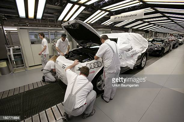 GERMANY Ingolstadt Car production at AUDI AG Our picture shows final inspection of the vehicle and attach the bag