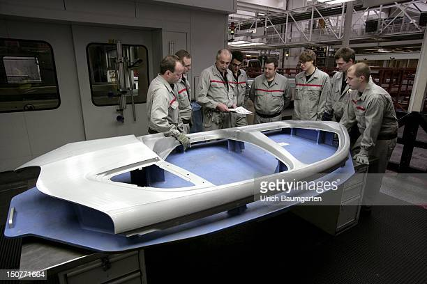 GERMANY Ingolstadt Car production at AUDI AG Our picture shows review / quality control in car body manufacturing plant