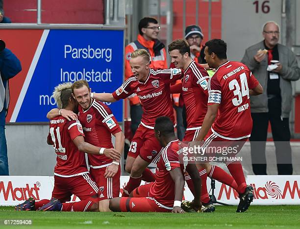 Ingolstadt celebrate their third goal during the German first division Bundesliga football match between FC Ingolstadt 04 and Borussia Dortmund in...