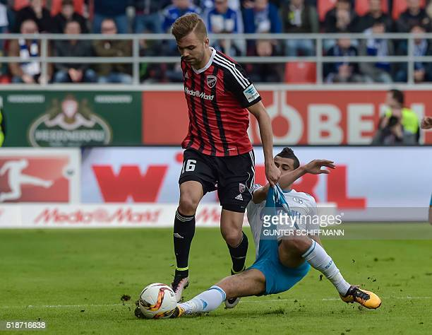 Ingolstadt's Austrain forward Lukas Hinterseer and Schalke's FrenchMoroccan midfielder Younes Belhanda vie for the ball during the German first...