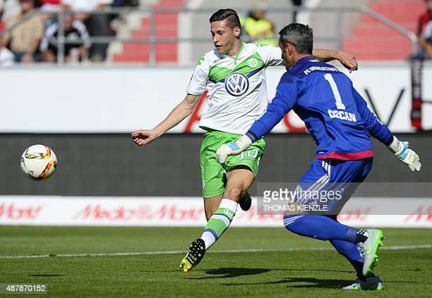 Ingolstadt's Austrian goalkeeper Ramazan Oezcan and Wolfsburg's midfielder Julian Draxler vie for the ball during the German first division...