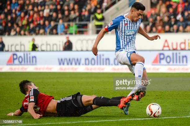 Ingolstadt's Benjamin Huebner and Hoffenheim's Nadiem Amiri compete for the ball during the German Bundesliga football match between FC Ingolstadt...