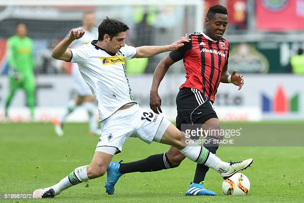 Ingolstadt's Brazilian midfielder Roger de Oliveira Bernardo and Moenchengladbach's midfielder Lars Stindl vie for the ball during the German first...