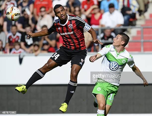 Ingolstadt's defender Marvin Matip and Wolfsburg's midfielder Julian Draxler vie for the ball during the German first division Bundesliga football...