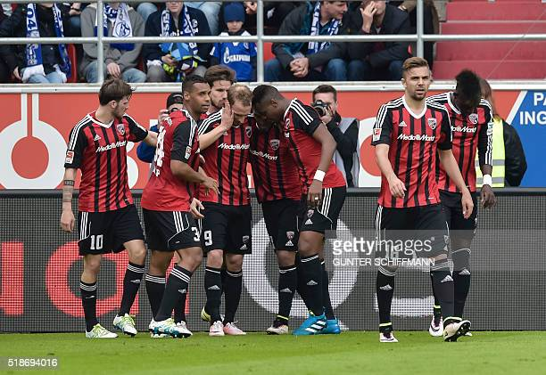 Ingolstadt's forward Moritz Hartmann celebrates scoring with teammates during the German first division Bundesliga football match FC Ingolstadt 04 vs...