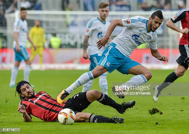 Ingolstadt's Israeli midfielder Almog Cohen and Schalke's FrenchMoroccan midfielder Younes Belhanda vie for the ball during the German first division...