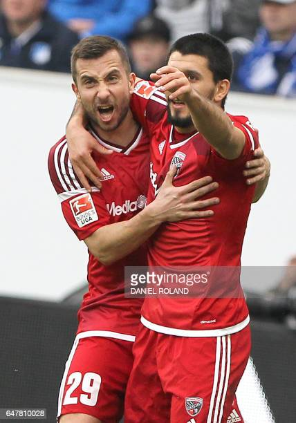 Ingolstadt's Israeli midfielder Almog Cohen celebrates with Ingolstadt's Austrian defender Markus Suttner scoring the 11 during the German First...