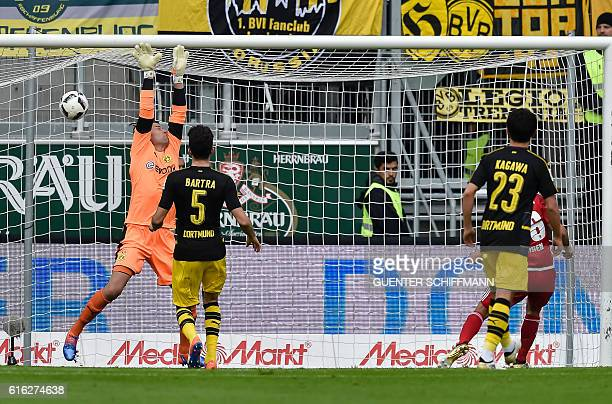 Ingolstadt's Israeli midfielder Almog Cohen scores the opening goal past Dortmund's goalkeeper Roman Weidenfeller during the German first division...